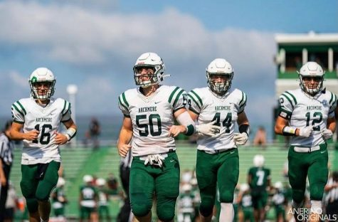 Archmere Football Captains Chris Albero, Kevin DeGregorio, Kieran Udovich, and Conor Udovich return from the opening coin toss.  Photo by Mr. Chuck Anerino (P23)
