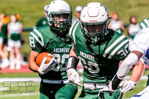Declan Pearson sets up a block for Johnny Kim as Archmere marches down the field. Photo taken by Gee Johnson.