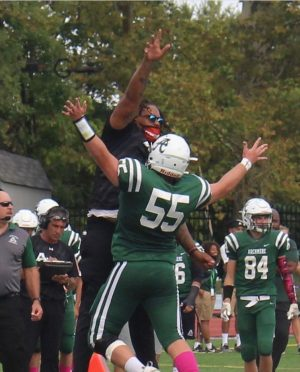Senior Conor France celebrates with lineman Coach G after the touchdown. Photo credits go to Mr. Zondlo P21